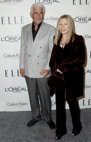 Barbra Streisand, right, and James Brolin arrive at the 18th Annual ELLE Women in Hollywood celebration in Beverly Hills, Calif., Monday, Oct. 17, 2011.  The dinner celebrates women's achievements in film. (AP Photo/Matt Sayles)
