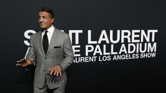 Actor Stallone poses as he arrives for the Saint Laurent fall collection fashion show at the Hollywood Palladium in Los Angeles