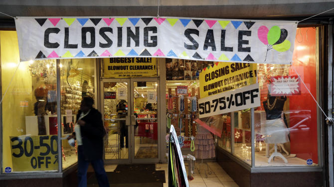 "In this Tuesday, Dec. 18, 2012 photo, a person exits a business with a ""Closing Sale"" sign, in Philadelphia. Confidence among U.S. consumers has sunk to its lowest point since July, according to a monthly index released Friday, Dec. 21, 2012. The University of Michigan says its consumer sentiment index for December fell to 72.9, a sharp drop from the November reading of 82.7. The November figure was a five-year high. (AP Photo/Matt Rourke)"