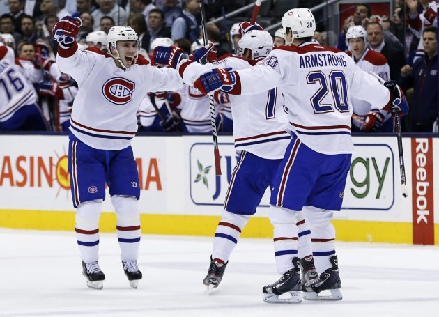 Montreal Canadiens' Emeli, Markov, and Armstrong celebrate Emeli's goal against Toronto Maple Leafs during their NHL hockey game in Toronto