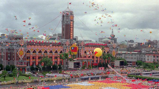 FILE - In this Oct. 10, 1996 file photo,  tens of thousands of performers and guests attend the Republic of China's National Day celebrations in Taipei.  Spurned by the international community, ignored in the land of its founding, and ridiculed by many of its own people, the Republic of China celebrates the 100th anniversary of its birth Monday, trying to stave off extinction. (AP Photo/Chang Liang-yi, File)