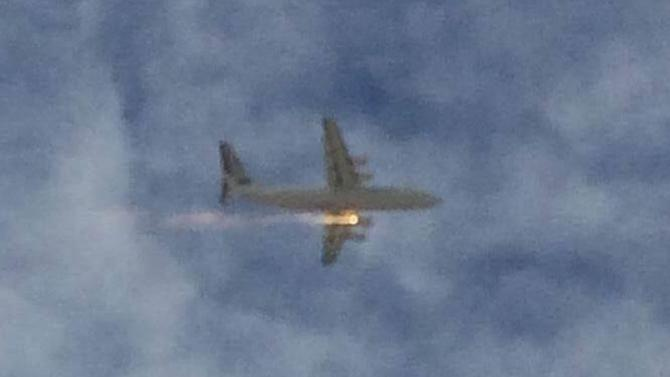 Passenger captures video as airplane's engine bursts into flames
