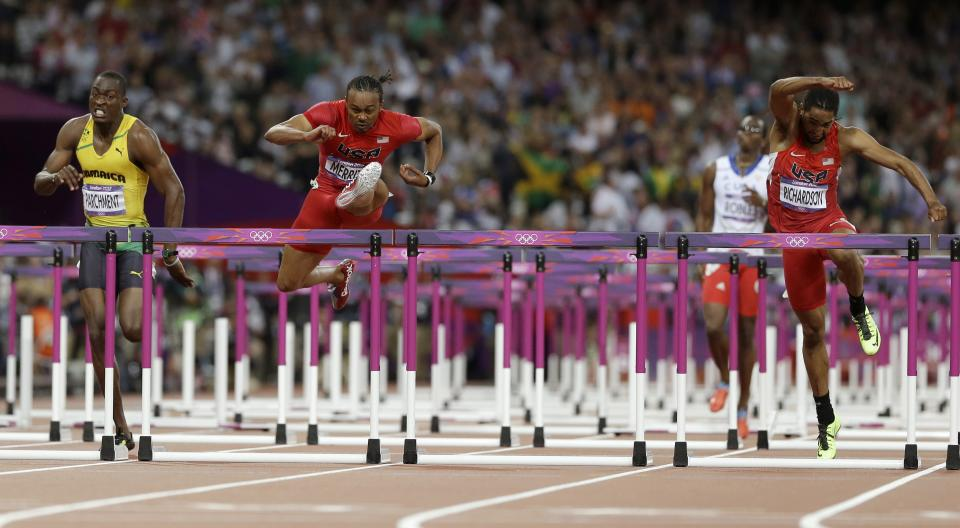United States' Aries Merritt wins the men's 110-meters hurdles final ahead of compatriot Jason Richardson, right, and Jamaica's Hansle Parchment, left, during the athletics in the Olympic Stadium at the 2012 Summer Olympics, London, Wednesday, Aug. 8, 2012.   (AP Photo/Anja Niedringhaus)