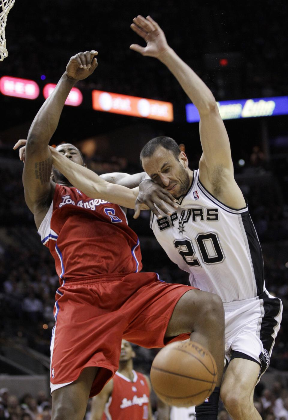 San Antonio Spurs' Manu Ginobili, right, of Argentina, loses the ball as Los Angeles Clippers' DeAndre Jordan defends during the second quarter of Game 1 of an NBA basketball Western Conference semifinal playoff series, Tuesday, May 15, 2012, in San Antonio. (AP Photo/Eric Gay)