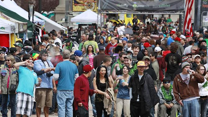 Crowds begin to gather at the Denver 4/20 pro-marijuana rally at Civic Center Park in Denver on Saturday, April 20, 2013. Authorities generally look the other way at public pot smoking here on April 20. Police said this week they're focused on crowd security in light of attacks that killed three at the finish line of the Boston Marathon. (AP Photo/Brennan Linsley)