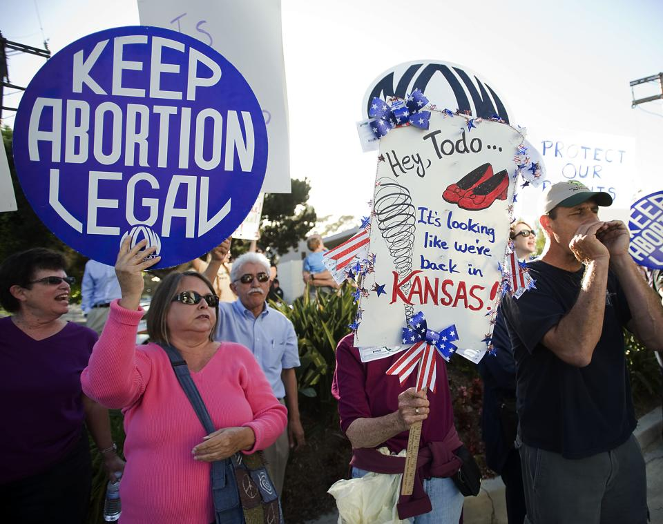 Pro-Choice demonstrators gather outside Hoag Hospital in Newport Beach Thursday June 20, 2013 to protest the hospital's decision to stop all abortions. (AP Photo/Orange County Register, Rose Palmisano)