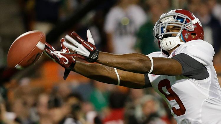 Alabama wide receiver Amari Cooper can't quite come up with a reception during the first half of the BCS National Championship college football game against Notre Dame Monday, Jan. 7, 2013, in Miami. (AP Photo/David J. Phillip)