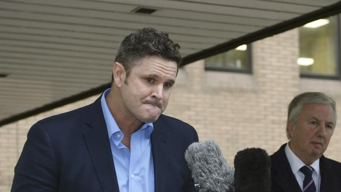 Former New Zealand cricket captain Chris Cairns speaks to members of the media outside Southwark Crown Court in London