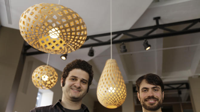 In this photo taken Thursday April 26, 2012, Dustin Moskovitz, left, and Justin Rosenstein, right, co-founders of the collaborative software company Asana, pose outside of their offices in San Francisco. Facebook co-founder and former Mark Zuckerberg roommate Dustin Moskovitz is by many accounts the world's youngest self-made billionaire. But the 27-year-old isn't sipping champagne in the Caribbean. Instead he's thrown himself back into San Francisco's startup churn with an online collaboration app he says will become the world's next $100 billion company. (AP Photo/Eric Risberg)