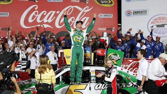 Kasey Kahne celebrates in victory lane after winning the NASCAR Coca-Cola 600 Sprint Cup Series auto race in Concord, N.C., Sunday, May 27, 2012. (AP Photo/Terry Renna)