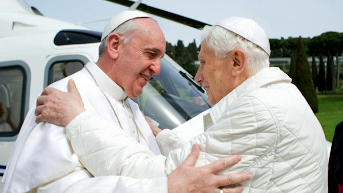 "In this photo provided by the Vatican paper L'Osservatore Romano, Pope Francis meets Pope emeritus Benedict XVI in Castel Gandolfo Saturday, March 23, 2013. Pope Francis has traveled to Castel Gandolfo to have lunch with his predecessor Benedict XVI in a historic and potentially problematic melding of the papacies that has never before confronted the Catholic Church. The Vatican said the two popes embraced on the helipad. In the chapel where they prayed together, Benedict offered Francis the traditional kneeler used by the pope. Francis refused to take it alone, saying ""We're brothers,"" and the two prayed together on the same one. (AP Photo/Osservatore Romano, HO)"