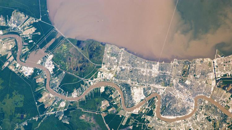 This image provided by NASA taken on May 17, 2011 shows shows a muddy plume in lake Pontchartrain, as well as the sediment-clogged Mississippi River meandering through the city of New Orleans. Water flowing through the Bonnet Carré spillway into Lake Pontchartrain is also muddy brown. (AP Photo/NASA)