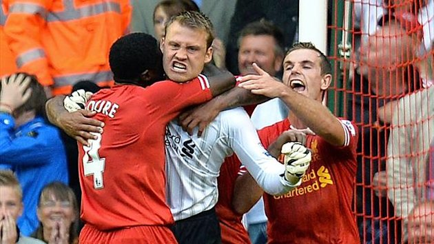 Kolo Toure, Simon Mignolet and Daniel Agger celebrate the goalkeeper's penalty save (AFP)