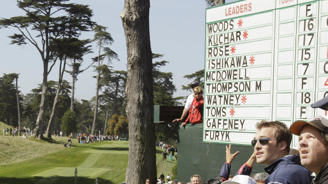 Graeme McDowell, of Northern Ireland, hits out of the gallery on the eighth hole during the first round of the U.S. Open Championship golf tournament Thursday, June 14, 2012, at The Olympic Club in San Francisco. (AP Photo/Charlie Riedel)