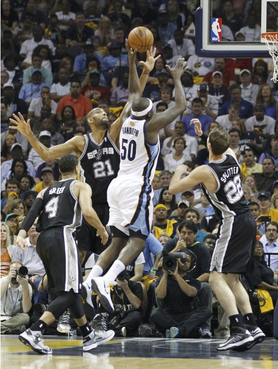 Grizzlies' Zach Randolph shoots over Spurs' Tim Duncan during the first quarter in Game 3 of their NBA Western Conference final playoff basketball series in Memphis