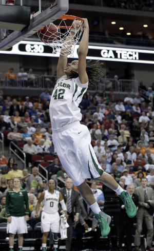 FILE - This March 24, 2012 file photo shows Baylor center Brittney Griner dunking the ball during the second half of an NCAA women's tournament regional semifinal college basketball game against Georgia Tech,  in Des Moines, Iowa. Griner became only the second four-time All-American when she was honored by The Associated Press on Tuesday, March 27, 2012. (AP Photo/Charlie Neibergall, File)