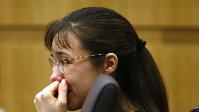 """Jodi Arias cries as she listens to Steven Alexander, brother of murder victim Travis Alexander, makes his """"victim impact statement"""" to the jury on Thursday, May 16, 2013, during the penalty phase of the Jodi Arias trial at Maricopa County Superior Court in Phoenix.  Jodi Arias was convicted of first-degree murder in the stabbing and shooting to death of Travis Alexander, 30, in his suburban Phoenix home in June 2008. (AP Photo/The Arizona Republic, Rob Schumacher, Pool)"""