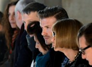 David Beckham (C) sits next to Vogue magazine editor Anna Wintour (2nd R) at the Victoria Beckham show during the Mercedes-Benz Fashion Week Fall 2013 collections on February 10, 2013 in New York