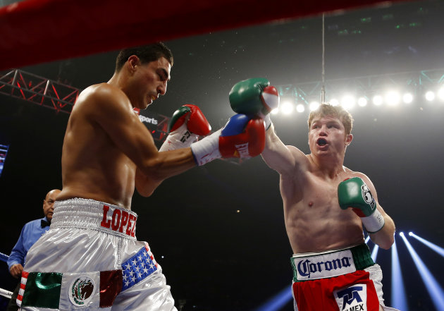 Canelo Alvarez, right, of Mexico, punches Josesito Lopez during a WBC super welterweight championship boxing match on Saturday, Sept. 15, 2012, in Las Vegas. (AP Photo/Isaac Brekken)