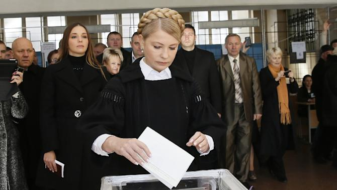 This handout picture taken by the Batkivschyna party shows the leader of the party and former Ukrainian prime minister, Yulia Tymoshenko, casting her ballot in a polling station on October 26, 2014