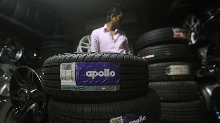 An employee works inside a showroom selling Apollo tyres in Mumbai June