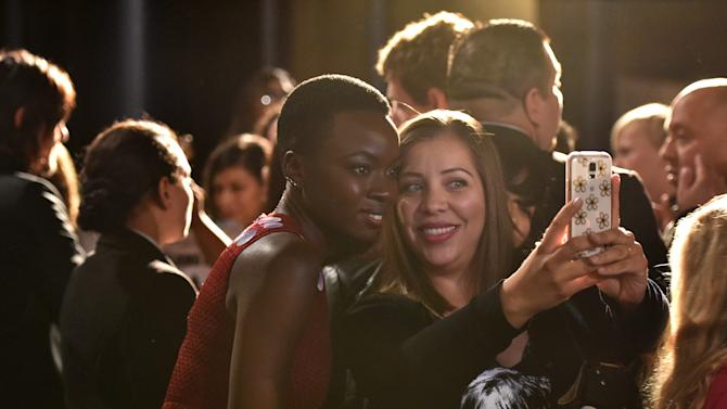 "Danai Gurira is seen with fans at ""The Walking Dead"" ATAS FYC event at the Egyptian Theater on Monday, April 20, 2015 in Los Angeles. (Photo by John Shearer/Invision for AMC/AP Images)"