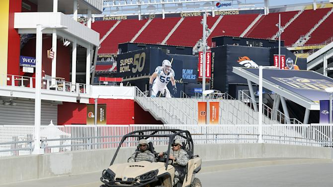 U.S. military are pictured on patrol before NFL Super Bowl 50 outside Levi's Stadium in Santa Clara, California,
