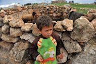 A Syrian boy is pictured near a makeshift refugee camp in the mountains in the area of Kerbet al-Khaldiye, on the Syria-Turkey border, on March 28, 2013. The UN is hiking its estimates of people trapped in Syria after fleeing their homes, saying Wednesday some four million are now displaced inside the country and in dire need of international help