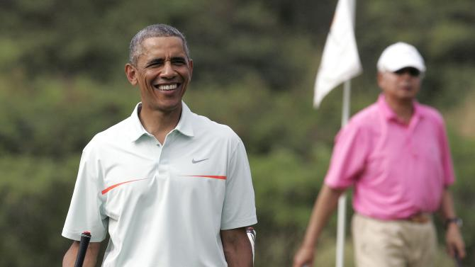U.S. President Barack Obama walks off the 18th green as he and Malaysia's Prime Minister Najib Razak finished up on the 18th hole in Hawaii