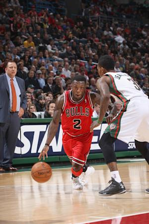 Robinson scores 24 to lead Bulls past Bucks