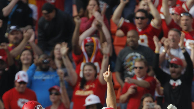 Kansas City Chiefs quarterback Brady Quinn (9) gestures after a touchdown pass during the first half of an NFL football game against the Carolina Panthers at Arrowhead Stadium in Kansas City, Mo., Sunday, Dec. 2, 2012. (AP Photo/Ed Zurga)