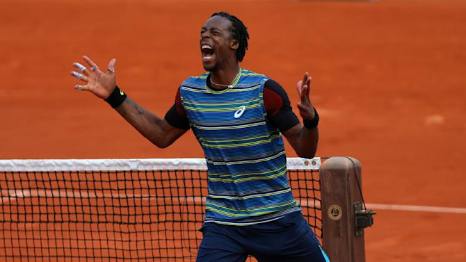 PARIS, FRANCE - MAY 27: Gael Monfils of France celebrates match point in his men's singles match against Tonas Berdych of Czech Republic during day two of the French Open at Roland Garros on May 27, 2013 in Paris, France. (Photo by Getty Images)