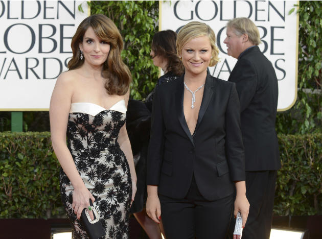 Show hosts Tina Fey, left, and Amy Poehler arrive at the 70th Annual Golden Globe Awards at the Beverly Hilton Hotel on Sunday Jan. 13, 2013, in Beverly Hills, Calif. (Photo by Jordan Strauss/Invision