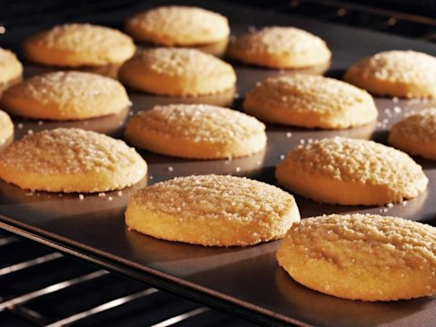 sugar cookies baking in an oven