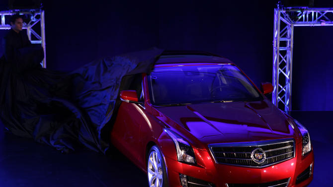 FILE - In this Sunday, Jan. 8, 2012, file photo, the 2013 Cadillac ATS is unveiled prior to the North American International Auto Show in Detroit. Seven midsize vehicles earned the top rating in a new insurance industry test of high-tech safety features designed to prevent front-end collisions, including the Cadillac ATS. (AP Photo/Paul Sancya)