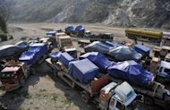 Trucks carrying supplies for NATO forces in Afghanistan are seen parked at Pakistan's Torkham border crossing after Pakistani authorities shut vital NATO supply routes in November 2011