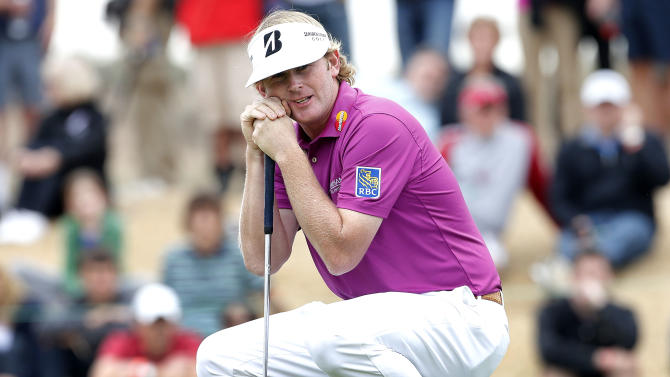 Brandt Snedeker reacts to a missed birdie putt on the 10th green during the final round of the Waste Management Phoenix Open golf tournament on Sunday, Feb. 3, 2013, in Scottsdale, Ariz. Snedeker finished in second place. (AP Photo/Matt York)