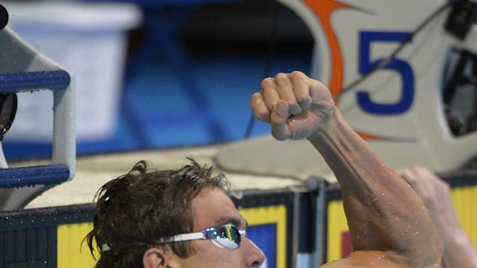 Nathan Adrian pumps his fist after winning the men's 100-meter freestyle final at the U.S. Olympic swimming trials, Friday, June 29, 2012, in Omaha, Neb. (AP Photo/Mark J. Terrill)