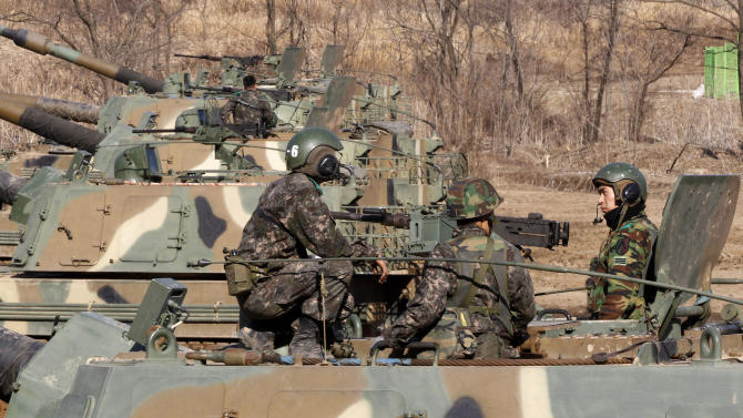 South Korean Army soldiers sit on their K-9 self-propelled artillery vehicle during an exercise against possible attacks by North Korea near the border village of Panmunjom in Paju, South Korea, Monday, March 11, 2013. South Korea and the U.S. on Monday kicked off an annual military drill amid worries about a possible bloodshed following North Korea's threat to scrap a decades-old war armistice and launch a nuclear attack on the U.S. (AP Photo/Ahn Young-joon)