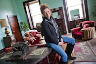This Friday, Dec. 16, 2011 photo shows Rebecca Jordan in the newly renovated superintendent's office at the Trans-Allegheny Lunatic Asylum in Weston, W. Va. The former psychiatric hospital is now being marketed as a historic and paranormal tourist attraction. Jordan's family owns and operates the facility. (AP Photo/David Smith)
