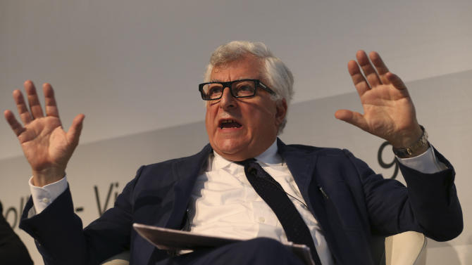 In this photo taken on June 13 2013, Prada fashion group CEO Patrizio Bertelli attends a conference on fashion in Milan. Concern that Milan is losing prestige to London, Paris and New York is cracking the well-appointed composure of Milan's fashion world. The Italian National Fashion Chamber has been moved to action, announcing a reorganization this spring and making Prada's outspoken CEO Patrizio Bertelli the No. 2, with the goal of revitalizing Milan fashion. (AP Photo/Luca Bruno)