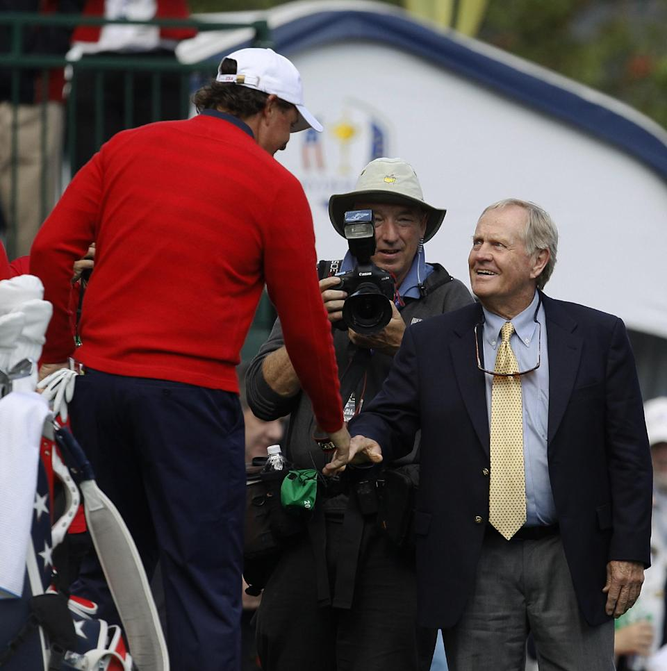 USA's Phil Mickelson, left, shakes hands with Jack Nicklaus on the first hole before a singles match at the Ryder Cup PGA golf tournament Sunday, Sept. 30, 2012, at the Medinah Country Club in Medinah, Ill. (AP Photo/Charles Rex Arbogast)