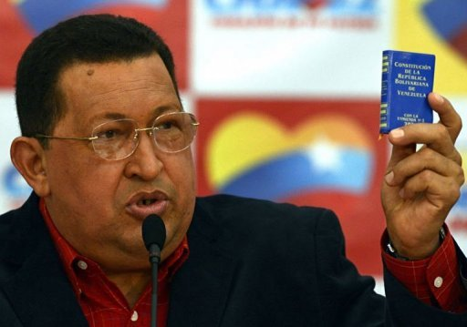 "<p>Venezuelan President Hugo Chavez shows a national Constitution during a press conference in Caracas. Chavez insisted Monday he is ""totally"" cancer-free a little more than a year since he first revealed his diagnosis and said he was ready to take on a re-election battle.</p>"