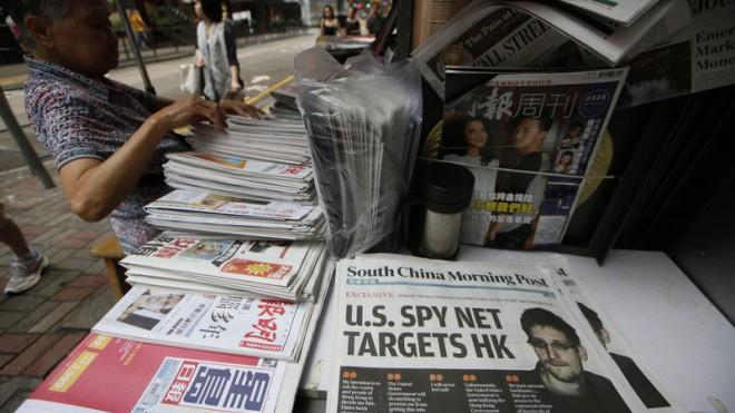 The front page of South China Morning Post is displayed at a news stand in Hong Kong on June 13.