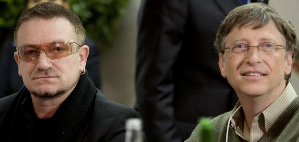 FILE This is a Saturday Jan. 26, 2008,  file photo of Irish musician Bono, left, and Chairman of Microsoft Corporation, Bill Gates, are seen at the start of a meeting at the World Economic Forum, in Davos, Switzerland,  (AP Photo/Peter Dejong, Pool, File)