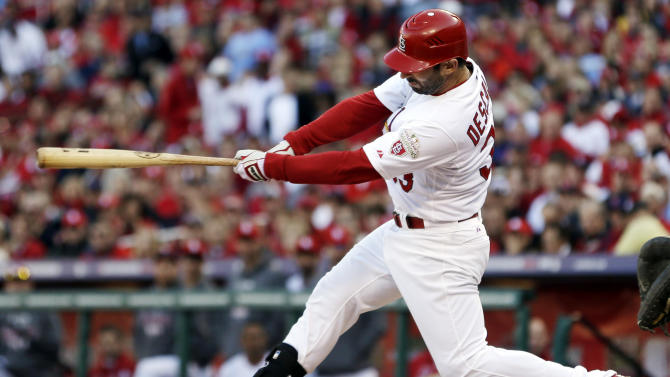 St. Louis Cardinals' Daniel Descalso hits an RBI single to score Yadier Molina during the second inning in Game 2 of baseball's National League division series against the Washington Nationals, Monday, Oct. 8, 2012, in St. Louis. (AP Photo/Jeff Roberson)