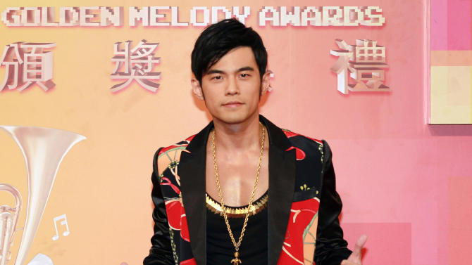"""FILE - In this July 6, 2013 file photo, Taiwanese singer Jay Chou arrives for the 24th Golden Melody Awards in Taipei, Taiwan. Chou wasn't afraid to spend money to make his second directorial feature, """"The Rooftop,"""" into a work of art. Nor is the Taiwanese superstar afraid of addressing criticism of his acting, something for which he has been berated ever since 2007's """"Secret."""" He says he's more open now and acting has become more natural for him. (AP Photo/Wally Santana, File)"""