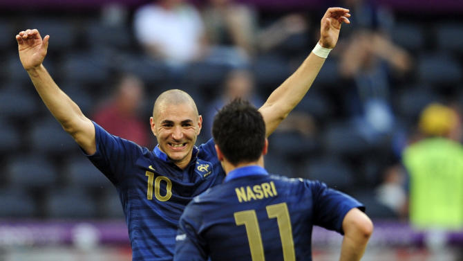 France's Samir Nasri, foreground, and teammate Karim Benzema, celebrate after Nasri scored a goal  during the Euro 2012 soccer championship Group D match between France and England in Donetsk, Ukraine, Monday, June 11, 2012. (AP Photo/Manu Fernandez)