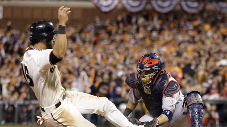 San Francisco Giants' Angel Pagan is tagged out at home by St. Louis Cardinals catcher Yadier Molina during the seventh inning of Game 7 of baseball's National League championship series Monday, Oct. 22, 2012, in San Francisco. (AP Photo/Ben Margot)