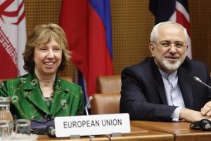 European Union foreign policy chief Ashton and Iranian Foreign Minister Zarif smile at the begin of talks in Vienna